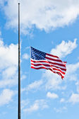 Half staff American flag — Stock Photo