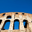 Colosseum with blue sky — Stock Photo #9941077