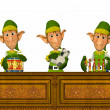 Three Christmas Elves making toys — Stock Photo