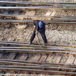 Maintenance worker fixing railway bolts - Stok fotoraf