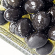 Black olives in olive oil - Stock Photo