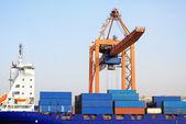 Cargo Ship under crane — Stock Photo