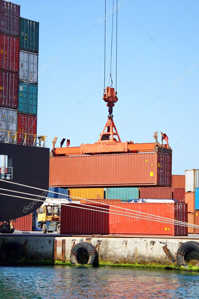 Freight container on lift in sea port  Stock Photo #9342297