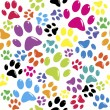 Stock Vector: Seamless pattern with colored paws