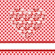 Textile patchwork heart over tablecloth - Grafika wektorowa
