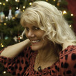 Middle age woman at christmas — Stock Photo #8680884