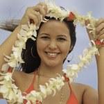 Постер, плакат: Hawaiian woman in bikini on the beach