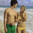 Young romantic couple at the beach — Stockfoto