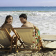 Young couple at the beach in hawaii - Foto Stock