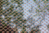 Rusty fence above blue sky — Stock Photo