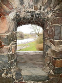 View through stone window in the wall of castle. — Stock Photo