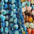 Lot of colored beads from different minerals - Foto Stock