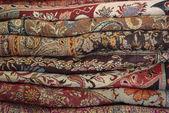 Pile Of Folded Colour Fabrics And Shawls — Stock Photo