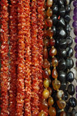 Lot of colored beads from different minerals — Stock Photo