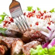 Fork and knife on a dish with rice and meat - Stock Photo