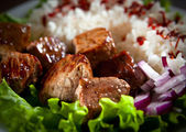 Fried meat with rice and vegetables — Stock Photo
