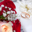 Gold wedding ring on flower - Stock Photo
