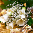 Gold wedding ring on flower — Stock Photo