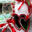 Ornament on wine glasses in the form of heart — Stock Photo