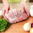 The frozen meat on a kitchen table. — Stock Photo