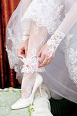 The bride dresses a wedding dress — Stock Photo