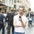 Young Man in City with mobile phone — Stock Photo #10007134
