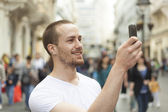 Man photographing with cell phone — Stock Photo