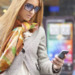 Woman with smartphone walking on street — Stock Photo #10056895