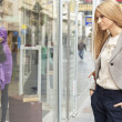 Woman in shoping street looking at window — Stock Photo