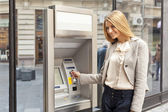 Woman use Bank ATM — Stock Photo