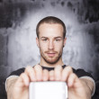 Man showing screen of smartphone, focus on guy — Stock Photo #10128252