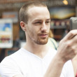 Men on street photographing with mobile phone — Stock Photo
