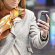Womans hand with cell phone — Stock Photo