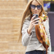 Stock Photo: Woman on street with smartphone