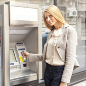 Woman using Bank ATM machine — Stock Photo