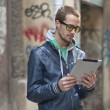Stock Photo: Man On Street Use Ipad Tablet Computer
