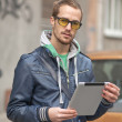 Man On Street Use Ipad Tablet Computer — Stock Photo #9911680
