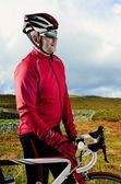 Cyclist and his bike — Stock Photo