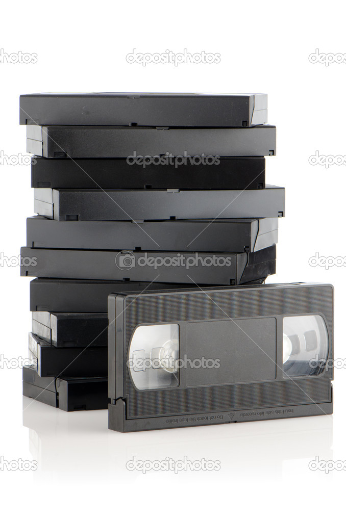 Pile of videotapes on  white reflective background. — Stock Photo #9393864