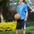 Teen boy with basketball — Stock Photo