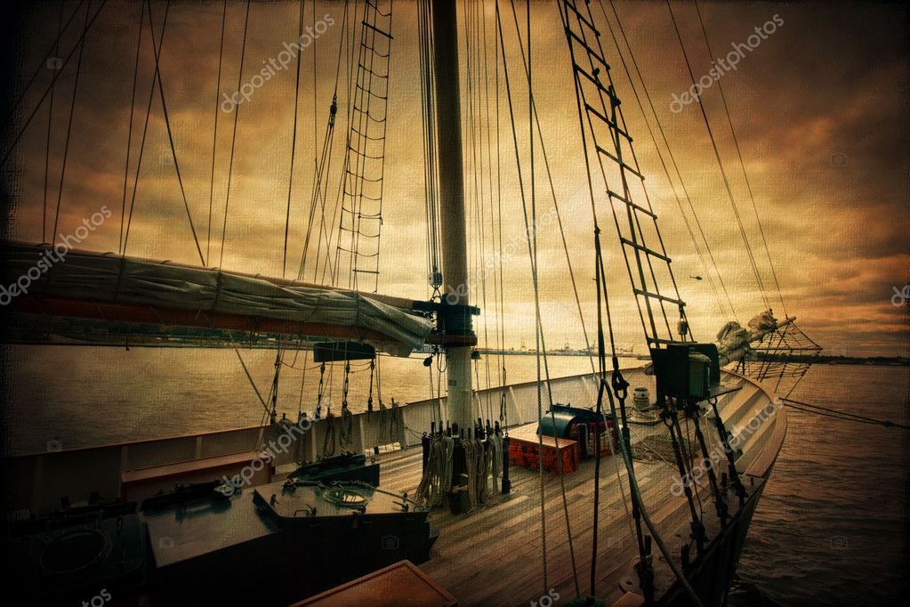 Vintage style image of a sailboat under ominous sky — Stock Photo #8254396