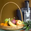 Stock Photo: Fruit and Electric Juicer