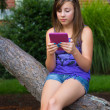 Girl with Digital Reader — Stock Photo