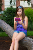 Girl with Digital Reader — Stock fotografie