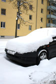 Car covered with snow in winter — Stock Photo