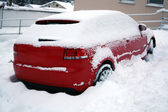 Red car covered — Stock Photo