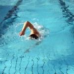 A man learn swim the crawl in water — Stock Photo #9043398