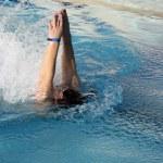 Young man swimming backstroke — Stock Photo