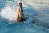 Young man swimming backstroke — Stock Photo