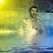 Man in the jacuzzi — Stock Photo